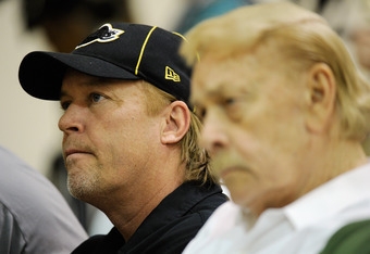 EL SEGUNDO, CA - MAY 31:  Jim Buss, executive vice president of basketball operations of the Los Angeles Lakers, listens to Lakers new coach Mike Brown's speach during his introductory news conference at the team's training facility on May 31, 2011 in El