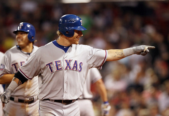BOSTON, MA - APRIL 17:  Josh Hamilton #32 of the Texas Rangers celebrates his three run homer in the eighth inning against the Boston Red Sox  on April 17, 2012 at Fenway Park in Boston, Massachusetts.  (Photo by Elsa/Getty Images)