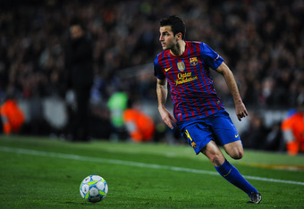 BARCELONA, SPAIN - MARCH 07:  Cesc Fabregas of FC Barcelona runs with the ball during the UEFA Champions League round of 16 second leg match between FC Barcelona and Bayern 04 Leverkusen at Camp Nou on March 7, 2012 in Barcelona, Spain. FC Barcelona won 7