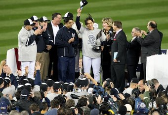 NEW YORK - NOVEMBER 04:  World Series MVP Hideki Matsui #55 of the New York Yankees celebrates with the MVP trophy after the Yankees 7-3 win against the Philadelphia Phillies in Game Six of the 2009 MLB World Series at Yankee Stadium on November 4, 2009 i