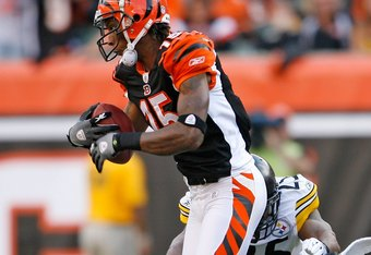 CINCINNATI - SEPTEMBER 27:  Chris Henry #15 of the Cincinnati Bengals runs with the ball against the Pittsburgh Steelers at Paul Brown Stadium on September 27, 2009 in Cincinnati, Ohio.  The Bengals won 23-20.  (Photo by Andy Lyons/Getty Images)