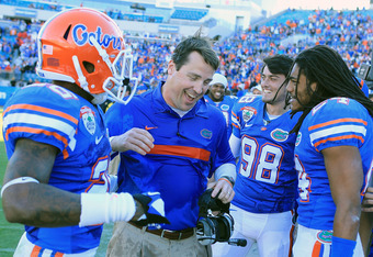 JACKSONVILLE, FL - JANUARY 02:  Head Coach Will Muschamp of the Florida Gators celebrates with his players after defeating the Ohio State Buckeyes 24-17 in the TaxSlayer.com Gator Bowl at EverBank Field on January 2, 2012 in Jacksonville, Florida.  (Photo