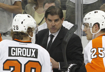 PITTSBURGH, PA - APRIL 20:  Philadelphia Flyers head coach Peter Laviolette talks to his team during a timeout against the Pittsburgh Penguins in Game Five of the Eastern Conference Quarterfinals during the 2012 NHL Stanley Cup Playoffs at Consol Energy C