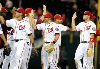 WASHINGTON, DC - APRIL 16:  The Washington Nationals celebrate after a 6-3 victory against the Houston Astros at Nationals Park on April 16, 2012 in Washington, DC.  (Photo by Greg Fiume/Getty Images)