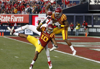 NEW YORK - DECEMBER 30:  Jacques Washington #10 and Leonard Johnson #23 of the Iowa State Cyclones break up a pass intended for Brandon Coleman #17 of the Rutgers Scarlet Knights during the New Era Pinstripe Bowl at Yankee Stadium on December 30, 2011 in