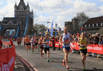 LONDON, ENGLAND - APRIL 22:  Runners Cross Tower Bridge during the Virgin London Marathon 2012 on April 22, 2012 in London, England.  (Photo by Tom Shaw/Getty Images)