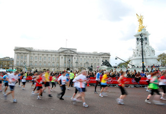 LONDON, ENGLAND - APRIL 22: Runners pass Buckingham Palace during the Virgin London Marathon 2012 on April 22, 2012 in London, England. (Photo by Tom Dulat/Getty Images)