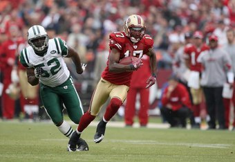 SAN FRANCISCO - DECEMBER 07:  Dominique Zeigler #17 of the San Francisco 49ers carries the ball against David Harris #52 of the New York Jets during an NFL game on December 7, 2008 at Candlestick Park in San Francisco, California. (Photo by Jed Jacobsohn/