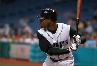TAMPA, FL - JUNE 15:  Outfielder Carl Crawford #13 of the Tampa Bay Devil Rays prepares to hit the ball against the Milwaukee Brewers during the game on June 15, 2005 at Tropicana Field in Tampa, Florida.  The Devil Rays won 5-3.  (Photo by Tim Boyles/Get