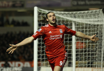 WOLVERHAMPTON, ENGLAND - JANUARY 31:  Andy Carroll of Liverpool celebrates his goal during the Barclays Premier League match between Wolverhampton Wanderers and Liverpool at Molineux on January 31, 2012 in Wolverhampton, England.  (Photo by Clive Mason/Ge