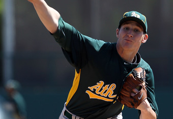 Jarrod Parker has had the honor of pitching in an A's uniform before, in spring training against the Dodgers when pictured here.