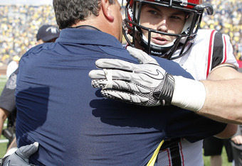 ANN ARBOR, MI - SEPTEMBER 24:  Michigan Wolverines head coach Brady Hoke and Miles Burris #9 of San Diego State meet on the field after the game at Michigan Stadium on September 24, 2011 in Ann Arbor, Michigan. Michigan defeated San Diego 28-7.  (Photo by