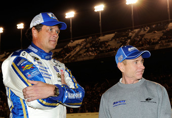 DAYTONA BEACH, FL - FEBRUARY 18: Michael Waltrip, driver of the #55 Aaron's Toyota and driver Mark Martin look on prior to the start of the NASCAR Budweiser Shootout at Daytona International Speedway on February 18, 2012 in Daytona Beach, Florida.  (Photo