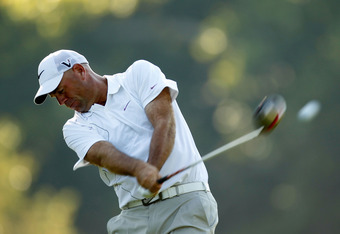 JOHNS CREEK, GA - AUGUST 11:  Stewart Cink hits a tee shot on the 14th hole during the first round of the 93rd PGA Championship at the Atlanta Athletic Club on August 11, 2011 in Johns Creek, Georgia.  (Photo by Mike Ehrmann/Getty Images)