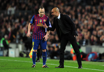 BARCELONA, SPAIN - APRIL 24:  Head coach Josep Guardiola of FC Barcelona gives instructions to Andres Iniesta of Barcelona during the UEFA Champions League Semi Final, second leg match between FC Barcelona and Chelsea FC at Camp Nou on April 24, 2012 in B