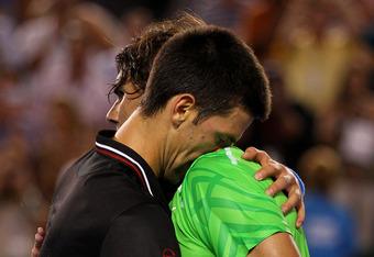 MELBOURNE, AUSTRALIA - JANUARY 29:  Novak Djokovic of Serbia hugs Raphael Nadal of Spain after his men's final match against Rafael Nadal of Spain during day fourteen of the 2012 Australian Open at Melbourne Park on January 29, 2012 in Melbourne, Australi