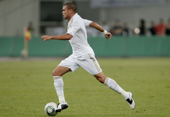 TIANJIN, CHINA - AUGUST 06:  Pepe of Real Madrid controls the ball during the pre-season friendly match between Tianjin Teda and Real Madrid at Water Drop Stadium on August 6, 2011 in Tianjin, China.  (Photo by Lintao Zhang/Getty Images)