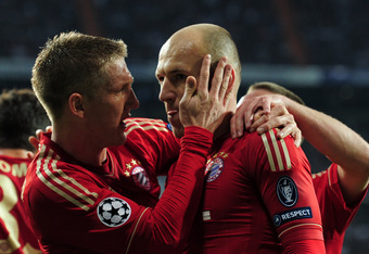 MADRID, SPAIN - APRIL 25:  Arjen Robben of Bayern Munich celebrates scoring from the penalty spot with Bastian Schweinsteiger during the UEFA Champions League Semi Final second leg between Real Madrid CF and Bayern Munich at The Bernabeu Stadium on April