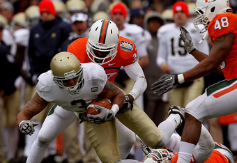 EL PASO, TX - DECEMBER 30:  Wide receiver Michael Floyd #3 of the Notre Dame Fighting Irish runs the ball past Jared Campbell #37, Sean Spence #31 and Andrew Smith #48 of the Miami Hurricanes at Sun Bowl on December 30, 2010 in El Paso, Texas.  (Photo by