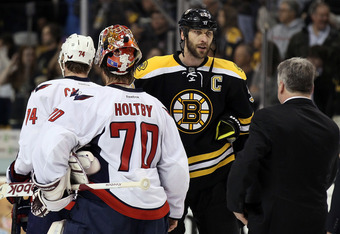 BOSTON, MA - APRIL 25: Zdeno Chara #33 of the Boston Bruins shakes hands with Braden Holtby #70 of the Washington Capitals after Game Seven of the Eastern Conference Quarterfinals during the 2012 NHL Stanley Cup Playoffs at TD Garden on April 25, 2012 in