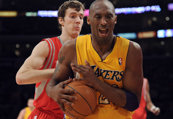 LOS ANGELES, CA - APRIL 06:  Kobe Bryant #24 of the Los Angeles Lakers reacts as he is fouled in front of Goran Dragic #3 of the Houston Rockets at Staples Center on April 6, 2012 in Los Angeles, California.  NOTE TO USER: User expressly acknowledges and
