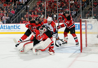 NEWARK, NJ - APRIL 24:  Goalie Martin Brodeur #30 of the New Jersey Devils makes a save in the third period in Game Six of the Eastern Conference Quarterfinals during the 2012 NHL Stanley Cup Playoffs at Prudential Center on April 24, 2012 in Newark, New