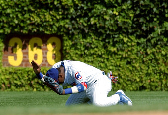 CHICAGO - SEPTEMBER 10:  Sammy Sosa #21 of the Chicago Cubs pounds the ground after missing a catch of a ball hit by Paul Lo Duca of the Florida Marlins during game one of a double header on September 10, 2004 at Wrigley Field in Chicago, Illinois. (Photo