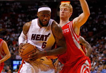 MIAMI, FL - APRIL 22:  LeBron James #6 of the Miami Heat drives on Chase Budinger #10 of the Houston Rockets during a game at American Airlines Arena on April 22, 2012 in Miami, Florida. NOTE TO USER: User expressly acknowledges and agrees that, by downlo