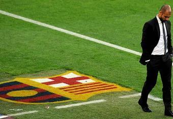 Pep walks away from FCB.
