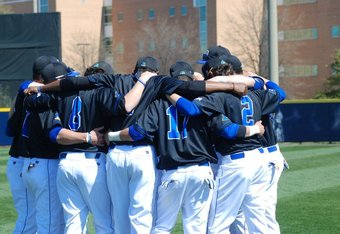 Delaware huddles before a game. Giacchino is number 2, to the right