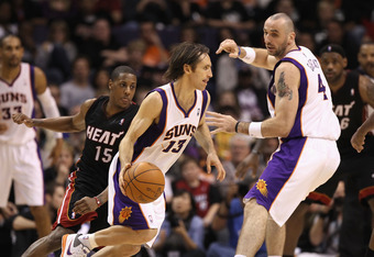 PHOENIX - DECEMBER 23:  Steve Nash #13 of the Phoenix Suns drives the ball against the Miami Heat during the NBA game at US Airways Center on December 23, 2010 in Phoenix, Arizona. The Heat defeated the Suns 95-83. NOTE TO USER: User expressly acknowledge