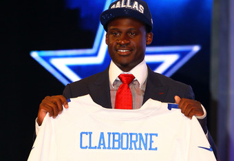 NEW YORK, NY - APRIL 26:  Morris Claiborne (R)from LSU holds up a jersey as he stands on stage after he was selected #6 overall by the Dallas Cowboys in the first round of during the 2012 NFL Draft at Radio City Music Hall on April 26, 2012 in New York Ci