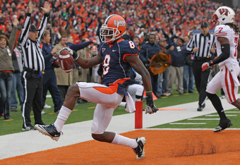CHAMPAIGN, IL - NOVEMBER 19: A.J. Jenkins #8 of the Illinois Fighting Illini moives across the end zone against the Wisconsin Badgers at Memorial Stadium on November 19, 2011 in Champaign, Illinois. Wisconsin defeated Illinois 28-17. (Photo by Jonathan Da