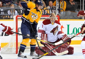 NASHVILLE, TN - DECEMBER 06:  Martin Erat #10 of the Nashville Predators tries to deflect a shot in front of Jason LaBarbera #1 of the Phoenix Coyotes at the Bridgestone Arena on December 6, 2011 in Nashville, Tennessee.  (Photo by Frederick Breedon/Getty