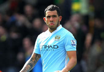 NORWICH, ENGLAND - APRIL 14:  Carlos Tevez of Manchester City claims the match ball after completing a hat trick during the Barclays Premier League match between Norwich City and Manchester City at Carrow Road on April 14, 2012 in Norwich, England.  (Phot