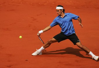 PARIS - JUNE 11:  Roger Federer of Switzerland in action against Rafael Nadal of Spain during the Men?s Singles Final on day fifteen of the French Open at Roland Garros on June 11, 2006 in Paris, France.  (Photo by Matthew Stockman/Getty Images)