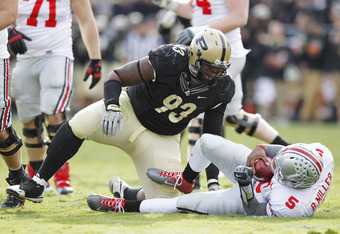 WEST LAFAYETTE, IN - NOVEMBER 12: Kawann Short #93 of the Purdue Boilermakers celebrates after sacking Braxton Miller #5 of the Ohio State Buckeyes at Ross-Ade Stadium on November 12, 2011 in West Lafayette, Indiana. Purdue defeated Ohio State 26-23 in ov