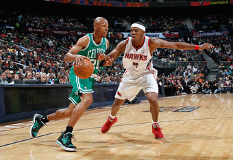 ATLANTA, GA - APRIL 01:  Ray Allen #20 of the Boston Celtics against Joe Johnson #2 of the Atlanta Hawks at Philips Arena on April 1, 2011 in Atlanta, Georgia.  NOTE TO USER: User expressly acknowledges and agrees that, by downloading and/or using this Ph