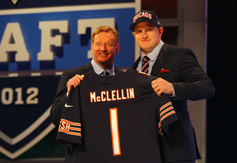 NEW YORK, NY - APRIL 26:  Shea McClellin (R) of Boise State holds up a jersey as he stands on stage with NFL Commissioner Roger Goodell after he was selected #19 overall by the Chicago Bears in the first round of the 2012 NFL Draft at Radio City Music Hal
