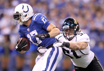 INDIANAPOLIS, IN - NOVEMBER 13:  Austin Collie #17 of the Indianapolis Colts runs with the ball while defended by Paul Posluszny #51 of the Jacksonville Jaguars at Lucas Oil Stadium on November 13, 2011 in Indianapolis, Indiana. The Jaguars won 17-3.  (Ph