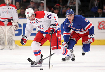 NEW YORK, NY - APRIL 07: Troy Brouwer #20 of the Washington Capitals skates with the puck in front of Ryan McDonagh #27 of the New York Rangers at Madison Square Garden on April 7, 2012 in New York City.  (Photo by Nick Laham/Getty Images)