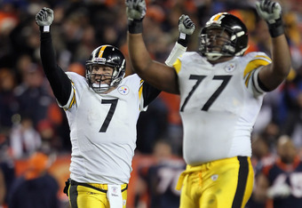 DENVER, CO - JANUARY 08:  Quarterback Ben Roethlisberger (L) #7 and Marcus Gilbert #77 of the Pittsburgh Steelers celebrate after Roethlisberger threw a touchdown pass against the Denver Broncos during the Wild Card Playoffs at Sports Authority Field at M