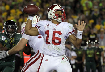 PASADENA, CA - JANUARY 02:  Quarterback Russell Wilson #16 of the Wisconsin Badgers throws the ball against the Oregon Ducks at the 98th Rose Bowl Game on January 2, 2012 in Pasadena, California.  (Photo by Stephen Dunn/Getty Images)
