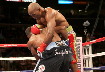 LOS ANGELES, CA - OCTOBER 15:  Bernard Hopkins (R) tangles with Chad Dawson as he falls to the canvas  in their WBC and Ring Magzine light heavyweight title fight at Staples Center on October 15, 2011 in Los Angeles, California. Hopkins injured his should