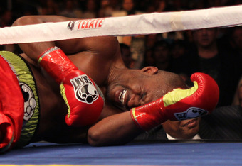LOS ANGELES, CA - OCTOBER 15:  Bernard Hopkins lies on the canva in pain after falling and injuring his shoulder in the second round against Chad Dawson in their WBC and Ring Magzine light heavyweight title fight at Staples Center on October 15, 2011 in L