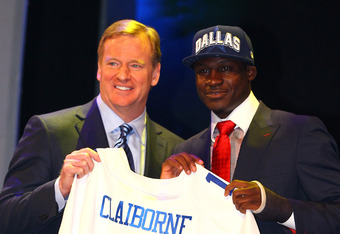 NEW YORK, NY - APRIL 26:  Morris Claiborne (R)from LSU holds up a jersey as he stands on stage with NFL Commissioner Roger Goodell after he was selected #6 overall by the Dallas Cowboys in the first round of during the 2012 NFL Draft at Radio City Music H