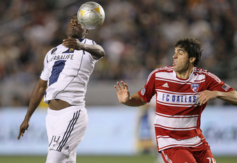 CARSON, CA - APRIL 28:  Edson Buddle #14 of the Los Angeles Galaxy jumps for the ball against George John #24 of FC Dallas at The Home Depot Center on April 28, 2012 in Carson, California.  (Photo by Stephen Dunn/Getty Images)