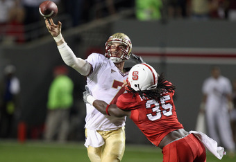 RALEIGH, NC - OCTOBER 28:  Christian Ponder #7 of the Florida State Seminoles drops back to throw a pass in pressure with Terrell Manning #35 of the North Carolina State Wolfpack giving chase during their game at Carter-Finley Stadium on October 28, 2010