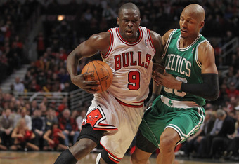 CHICAGO, IL - FEBRUARY 16:  Loul Deng #9 of the Chicago Bulls drives against Ray Allen #20 of the Boston Celtics at the United Center on February 16, 2012 in Chicago, Illinois. The Bulls defeated the Celtics 89-80. NOTE TO USER: User expressly acknowledge