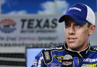 FORT WORTH, TX - APRIL 13:  Carl Edwards, driver of the #99 Fastenal Ford, answers questions from the media before practice for the NASCAR Sprint Cup Series Samsung Mobile 500 at Texas Motor Speedway on April 13, 2012 in Fort Worth, Texas.  (Photo by Rona